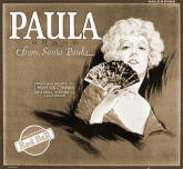 A second citrus box label titled Paula depicts a lady holding a fan. The two labels are often desplayed together.